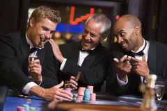 Three men gambling at roulette table Royalty Free Stock Images