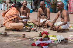 Three men and guru have mourning ritual Stock Image