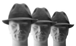 Three men with hats on Stock Image