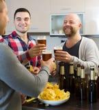 Three men  at house party Stock Photo