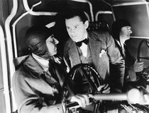 Three men inside of the cockpit of an airplane Royalty Free Stock Images