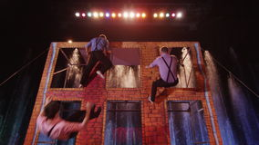 Three men jumping on trampoline in the circus stock video footage