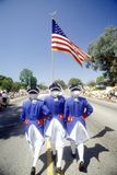 Three Men Marching in July 4th Parade, Pacific Palisades, California Royalty Free Stock Images