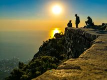 Three Men On Mountain Cliff Royalty Free Stock Image