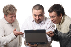 Three men with notebook. Looking at screen with surprise, isolated on white background Stock Images