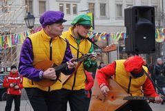 Three men play balalaikas. Royalty Free Stock Image