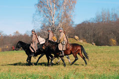 Three men ride horses Royalty Free Stock Images