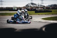 Three Men Riding on Go Karts stock image