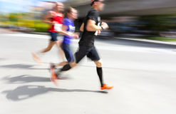 Three men in running competition Royalty Free Stock Photography