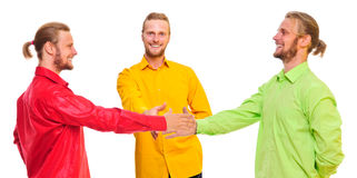 Three men shake hands Royalty Free Stock Images