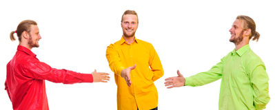 Three men shake hands Stock Photos