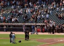 Three men sing the national anthem Stock Image