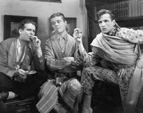 Three men smoking cigars Stock Photos