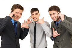 Three men talks into mobile phone Stock Image