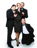 Three men in tuxedos and cheerful girl Royalty Free Stock Images