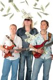 Three  men with two guitars and falling dollars. M Royalty Free Stock Image