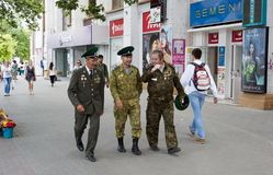 Three men chisinau. Three men, in uniform Moldavian army, around the city center of chisinau royalty free stock photo