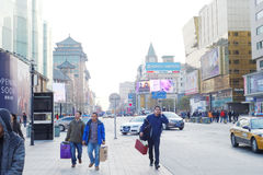 Three men walking in Wangfujing street Stock Images