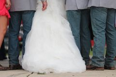 Three Men Wearing Gray Dress Shirt and Blue Denim Pants Between Woman in White Wedding Gown Royalty Free Stock Photo