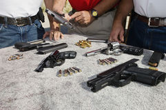 Free Three Men With Guns On Table Stock Photography - 29660182