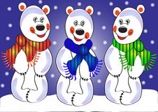 Three merry polar bears on snow Royalty Free Stock Images