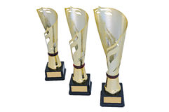 Three metal award cups of different height of gold color Royalty Free Stock Photos