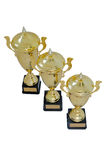 Three metal award cups of different height of gold color. For winners for the first second and third place are isolated on a white background. Top view stock photo