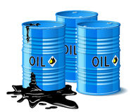 Three metal barrels with oil. Stock Image