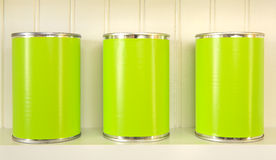 Three metal cans on a shelf Royalty Free Stock Images