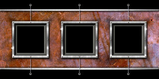 Three Metal Frames on a Grunge Wall Stock Images