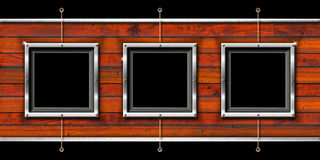 Three Metal Frames on a Grunge Wall Royalty Free Stock Images
