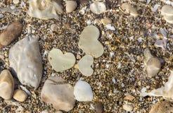 Three Metal Hearts Underwater. Stock Photo