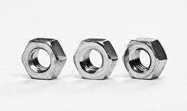 Three metal nuts Royalty Free Stock Images