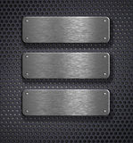 Three metal plates over grid background Stock Photo