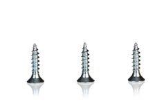 Three metal screws Stock Photography