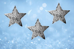 Three Metal Silver Star Christmas Ornaments Blue Royalty Free Stock Image