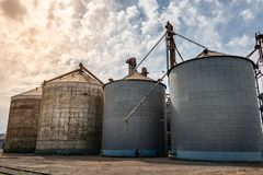 Three metal tanks for storage of grains stock photos