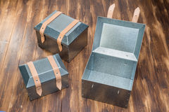 Three metal tool box on wooden table. Studio Shot royalty free stock photo