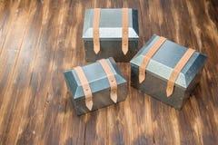 Three metal tool box on wooden table. Studio Shot stock photography