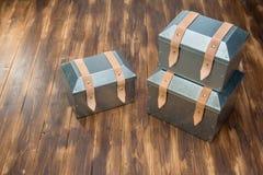 Three metal tool box on wooden table. Studio Shot stock photo