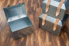 Three metal tool box on wooden table. Studio Shot royalty free stock image