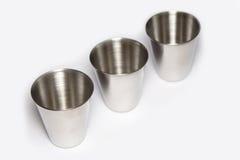 Three metal wineglass Stock Photos
