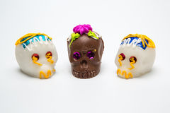 Three Mexican Calaverita de azucar Candy Skull and Calaverita de Chocolate, Stock Image