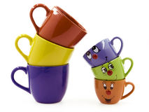 Three Middle Cups Beside Three Kid's Cups royalty free stock photography