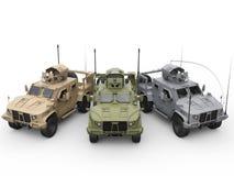 Three military all terrain vehicles - desert, jungle and urban camo colors Stock Photo