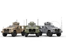 Three military all terrain vehicles - desert, jungle and urban camo colors Royalty Free Stock Image