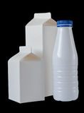 Three Milk Boxes per half liter  on black Royalty Free Stock Photos