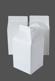 Three Milk Boxes per half liter on gray Stock Image