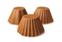 Three milk chocolate candies Stock Images