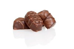Three milk chocolates Royalty Free Stock Photos